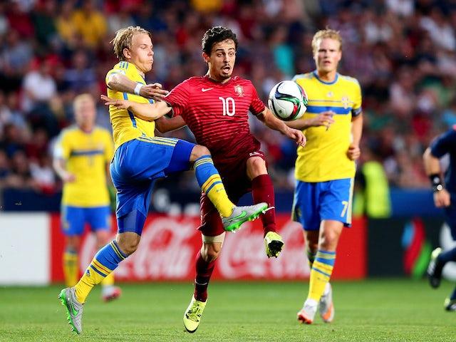 Oscar Lewicki (L) of Sweden and Bernardo Silva of Portugal battle for the ball during the UEFA European Under-21 final match between Sweden and Portugal at Eden Stadium on June 30, 2015