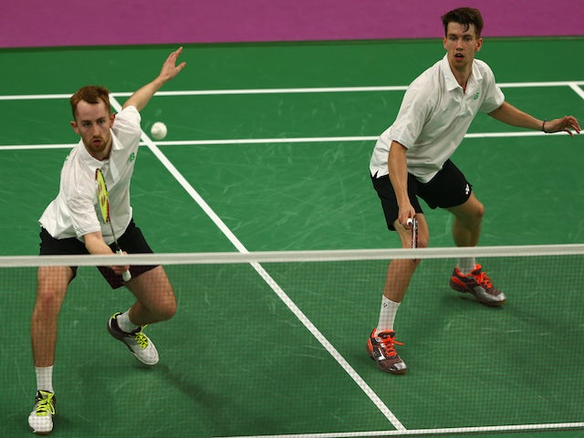 Sam Magee (L) and Joshua Magee (R) of Ireland compete during the Men's Doubles Group A match against Ricardo Silva and Angelo Silva of Portugal during day eleven of the Baku 2015 European Games at the Baku Sports Hall on June 23, 2015
