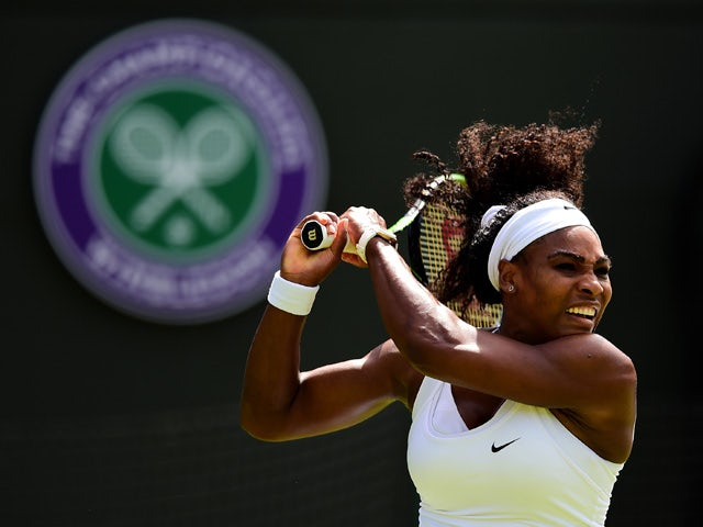 Serena Williams of the United States hits a backhand in her Ladies's Singles first round match against Margarita Gasparyan of Russia during day one of the Wimbledon Lawn Tennis Championships at the All England Lawn Tennis and Croquet Club on June 29,