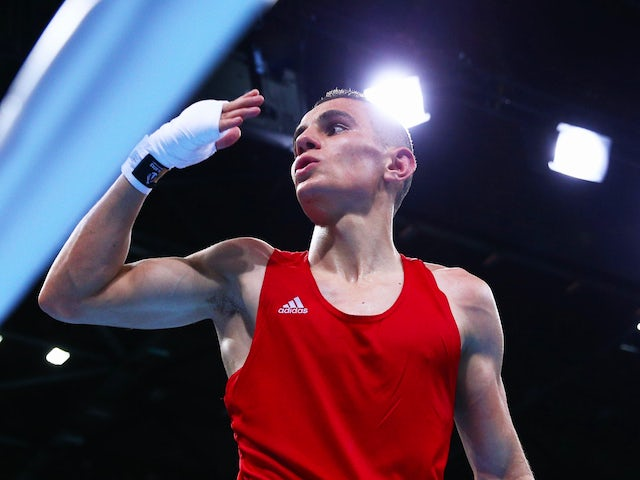 Tayfur Aliyev of Azerbaijan celebrates victory over Nicolae Andreiana of Romania in the Men's Bantam Weight (56kg) Round of 16 Bout during day seven of the Baku 2015 European Games at the Crystal Hall on June 19, 2015