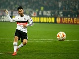 Tolgay Arslan of Besiktas scores his penalty in the shoot out during the 2nd leg of the UEFA Europa League Round of 32 match between Besiktas and Liverpool at the Ataturk Olympic Stadium on February 26, 2015