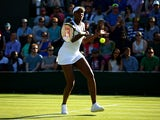Venus Williams of the United States plays a forehand in her Ladies Singles first round match against Madison Brengle of the United States during day one of the Wimbledon Lawn Tennis Championships at the All England Lawn Tennis and Croquet Club on June 29,