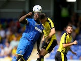 Adebayo Akinfenwa of AFC Wimbledon battles with Craig Cathcart of Watford during the Pre Season Friendly match between AFC Wimbledon and Watford at The Cherry Red Records Stadium on July 11, 2015