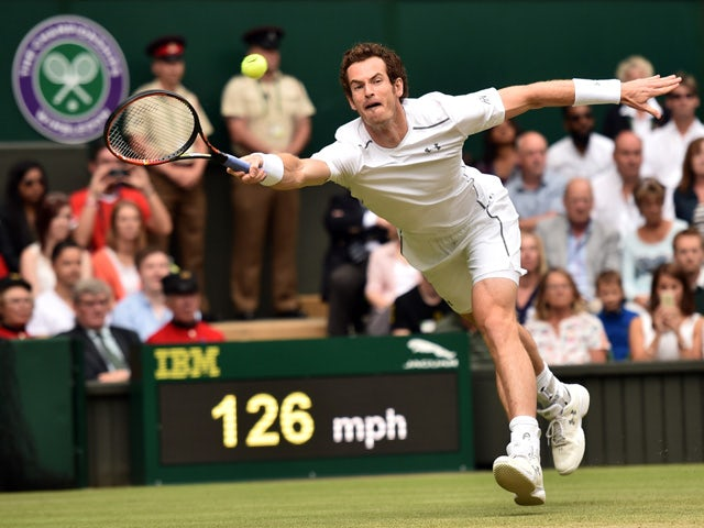 Britain's Andy Murray returns against Canada's Vasek Pospisil during their men's quarter-final match on day nine of the 2015 Wimbledon Championships at The All England Tennis Club in Wimbledon, southwest London, on July 8, 2015