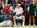 Andy Murray gestures to his team during the Wimbledon semi-final against Roger Federer on July 10, 2015