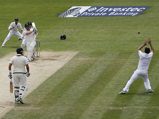 England's captain Alastair Cook makes a stunning catch to take the wicket of Australia's Brad Haddin during play on the fourth day of the opening Ashes cricket test match between England and Australia at The Swalec Stadium in Cardiff, south Wales, on July