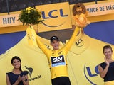 Great Britain's Christopher Froome celebrates his overall leader yellow jersey on the podium at the end of the 159.5 km third stage of the 102nd edition of the Tour de France cycling race on July 6, 2015