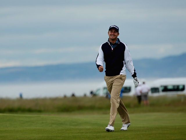 Daniel Brooks of England smiles on the 16th fairway during the second round of the Aberdeen Asset Management Scottish Open at Gullane Golf Club on July 10, 2015
