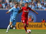Daniel Lovitz #19 of Toronto FC and Patrick Mullins #14 of New York City FC battle for the ball during a soccer game at Yankee Stadium on July 12, 2015
