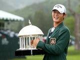 Danny Lee of New Zealand poses with the trophy after winning on the second hole of a sudden death playoff at the Greenbrier Classic held at The Old White TPC on July 5, 2015