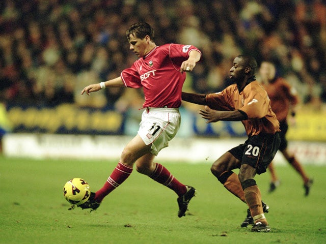 Darren Barnard of Barnsley reaches the ball ahead of Shaun Newton of Wolverhampton Wanderers during the Nationwide League Division One match played at Molineux on November 27, 2001