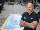 Former swimmer David Wilkie helps to open street pool art in the centre of Glasgow ahead of the IPC Swimming World Championships