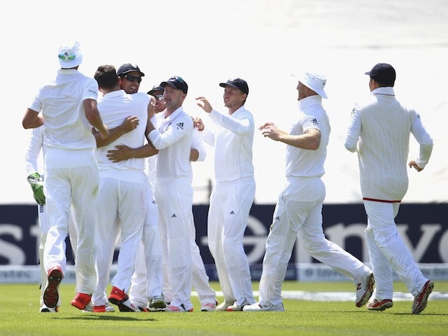 England players celebrate after David Warner is dismissed on day two of the First Test of The Ashes on July 9, 2015