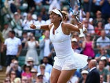 Garbine Muguruza of Spain celebrates match point in her Ladies Singles Quarter Final match against Timea Bacsinszky of Switzerland during day eight of the Wimbledon Lawn Tennis Championships at the All England Lawn Tennis and Croquet Club on July 7, 2015