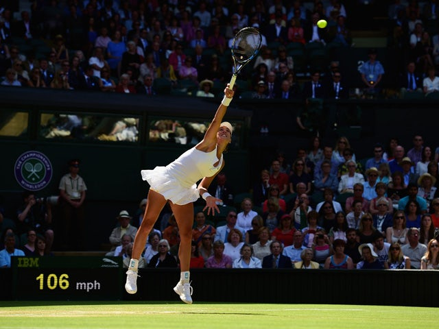Garbine Muguruza of Spain serves in the Ladies Singles Semi Final match against Agnieszka Radwanska of Poland during day ten of the Wimbledon Lawn Tennis Championships at the All England Lawn Tennis and Croquet Club on July 9, 2015