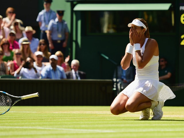 Garbine Muguruza of Spain celebrates after winning the Ladies Singles Semi Final match against Agnieszka Radwanska of Poland during day ten of the Wimbledon Lawn Tennis Championships at the All England Lawn Tennis and Croquet Club on July 9, 2015