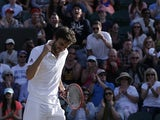 France's Gilles Simon celebrates beating Czech Republic's Tomas Berdych during their men's singles fourth round match on day seven of the 2015 Wimbledon Championships at The All England Tennis Club in Wimbledon, southwest London, on July 6, 2015