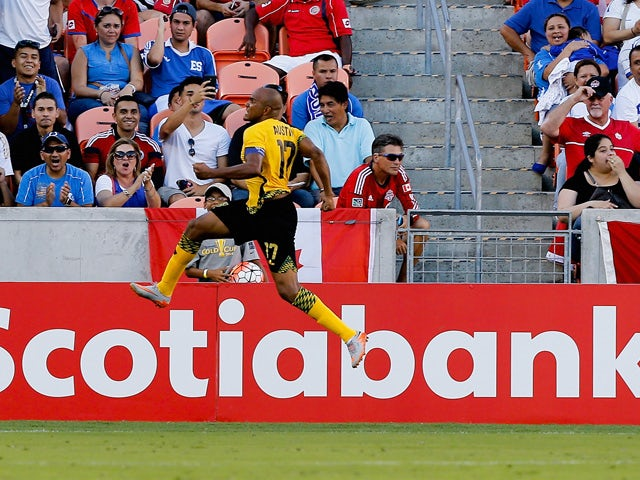 Rudolph Austin #17 of Jamaica celebrates his goal in stoppage time against the Canada at BBVA Compass Stadium on July 11, 2015