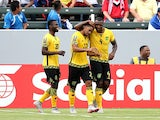 Jermaine Taylor #22 of Jamaica celebrates with Westley Morgan #4 and Kemar Lawrence #20 after his first half goal against Costa Rica in their CONCACAF Gold Cup Group B match at StubHub Center on July 8, 2015