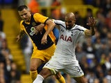Tottenham Hotspur's Brazilian midfielder Sandro (R) vies with AEL Limassol's Polish midfielder Lukasz Gikiewicz (L) during the UEFA Europa League qualifying round play-off second-leg football match between Tottenham Hotspur and AEL Limassol at White Hart