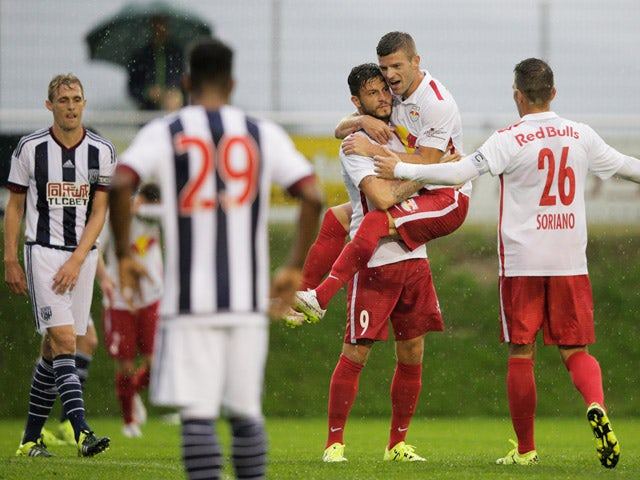 Marco Djuricin of Red Bull is congratulated by team mate Christoph Leitgeb after scoring a goal during the friendly match between Red Bull Salzburg and West Brom on July 8, 2015