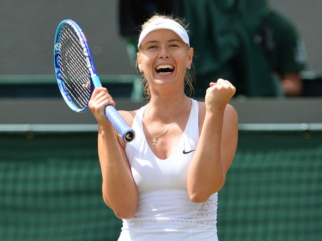 Russia's Maria Sharapova celebrates beating Kazakhstan's Zarina Diyas during their women's singles fourth round match on day seven of the 2015 Wimbledon Championships at The All England Tennis Club in Wimbledon, southwest London, on July 6, 2015