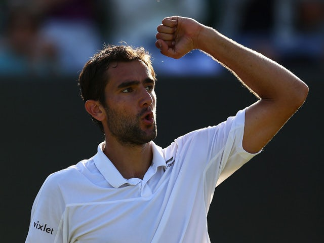 Marin Cilic of Croatia celebrates victory in his Gentlemen's Singles Fourth Round match against Denis Kudla of the United States during day seven of the Wimbledon Lawn Tennis Championships at the All England Lawn Tennis and Croquet Club on July 6, 2015