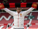 Dutch midfielder Memphis Depay poses with a scarf for a photograph as he is officially unveiled as a Manchester United player at Old Trafford stadium in Manchester, north west England on July 10, 2015