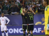 Mexican National Team forward Oribe Peralta (19) celebrates his goal with teammate Carlos Vela as Cuban National Team players look on during the second half of their CONCACAF Gold Cup soccer game at Soldier Field July 9, 2015
