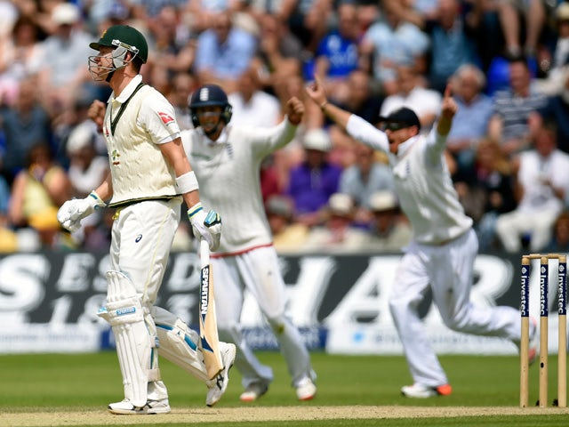 The England slips celebrate as Australia captain Michael Clarke reacts after being caught during day four of the 1st Investec Ashes Test match between England and Australia at SWALEC Stadium on July 11, 2015