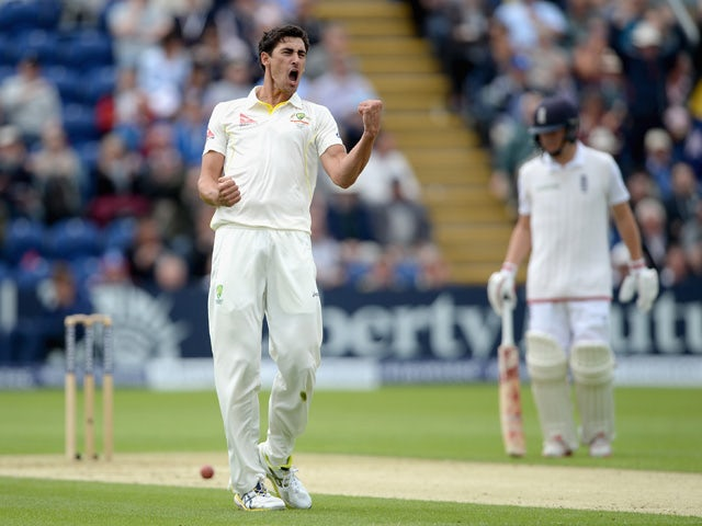 Mitchell Starc of Australia celebrates dismissing Ian Bell of England during day one of the 1st Investec Ashes Test match between England and Australia at SWALEC Stadium on July 8, 2015