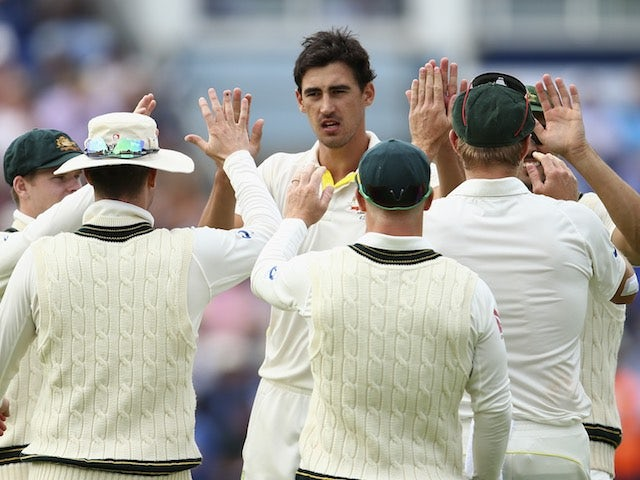 Australia's Mitchell Starc celebrates dismissing Moeen Ali on day two of the First Test of The Ashes on July 9, 2015