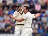 Nathan Lyon and Josh Hazlewood of Australia celebrate a wicket during day one of the first Test against England at the Swalec Stadium on July 8, 2015