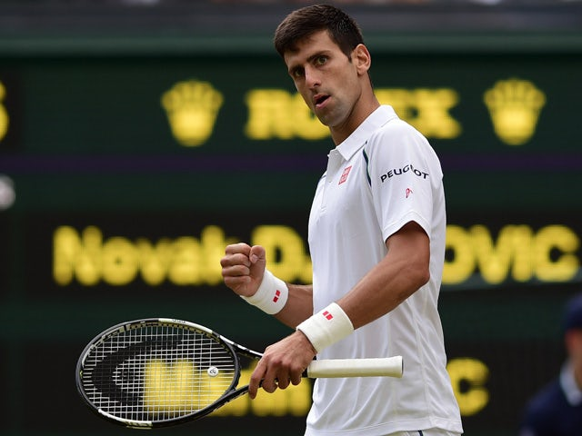 Serbia's Novak Djokovic reacts after breaking the serve of Croatia's Marin Cilic during their men's quarter-final match on day nine of the 2015 Wimbledon Championships at The All England Tennis Club in Wimbledon, southwest London, on July 8, 2015
