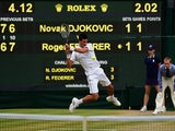 Novak Djokovic of Serbia plays a backhand in the Final Of The Gentlemen's Singles against Roger Federer of Switzerland on day thirteen of the Wimbledon Lawn Tennis Championships at the All England Lawn Tennis and Croquet Club on July 12, 2015