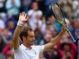 Richard Gasquet of France celebrates winning his Gentlemens Singles Quarter Final match against Stanislas Wawrinka of Switzerland during day nine of the Wimbledon Lawn Tennis Championships at the All England Lawn Tennis and Croquet Club on July 8, 2015