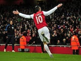 Arsenal's Dutch striker Robin Van Persie celebrates scoring his goal during the English Premier League football match between Arsenal and Everton at The Emirates Stadium in north London, England on December 10, 2011