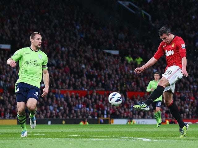 Robin van Persie of Manchester United scores his team's second goal during the Barclays Premier League match between Manchester United and Aston Villa at Old Trafford on April 22, 2013