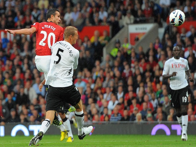 Manchester United's Dutch forward Robin van Persie (L) scores during the English Premier League football match between Manchester United and Fulham at Old Trafford in Manchester on August 25, 2012
