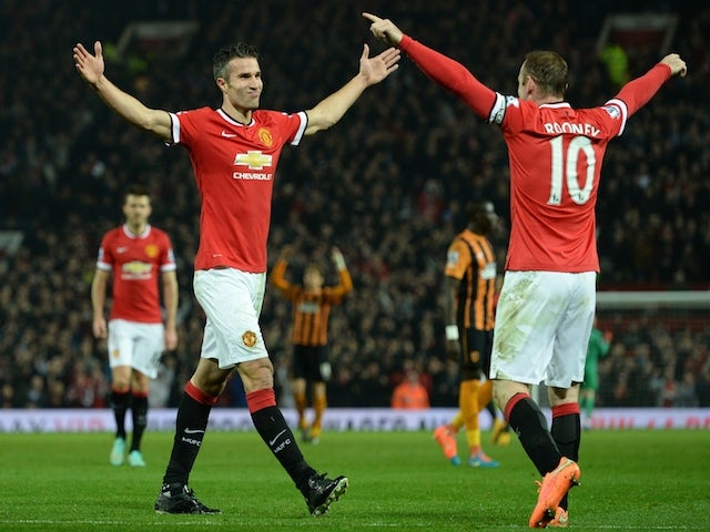 Manchester United's Dutch striker Robin van Persie (L) celebrates scoring their third goal with Manchester United's English striker Wayne Rooney (R) during the English Premier League football match between Manchester United and Hull City at Old Trafford i