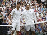 Serbia's Novak Djokovic (L) stands on court alongside Switzerland's Roger Federer ahead of their men's singles final match during the presentation on day thirteen of the 2014 Wimbledon Championships at The All England Tennis Club in Wimbledon, southwest L