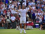 Switzerland's Roger Federer reacts after beating Spain's Roberto Bautista Agut during their men's singles fourth round match on day seven of the 2015 Wimbledon Championships at The All England Tennis Club in Wimbledon, southwest London, on July 6, 2015