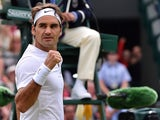Switzerland's Roger Federer reacts after beating France's Gilles Simon during their men's quarter-finals match on day nine of the 2015 Wimbledon Championships at The All England Tennis Club in Wimbledon, southwest London, on July 8, 2015