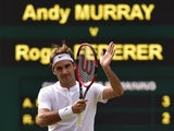 Roger Federer celebrates on Centre Court after his Wimbledon semi-final victory over Andy Murray on July 10, 2015