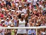 US player Serena Williams reacts after beating her sister US player Venus Williams during their women's singles fourth round match on day seven of the 2015 Wimbledon Championships at The All England Tennis Club in Wimbledon, southwest London, on July 6, 2