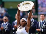 US player Serena Williams celebrates with the winner's trophy, the Venus Rosewater Dish, after her women's singles final victory over Spain's Garbine Muguruza on day twelve of the 2015 Wimbledon Championships at The All England Tennis Club in Wimbledon, s
