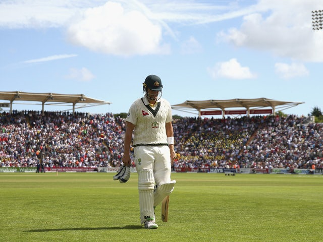 Shane Watson of Australia looks dejected after being dismissed LBW by Mark Wood of England during day four of the 1st Investec Ashes Test match between England and Australia at SWALEC Stadium on July 11, 2015
