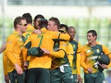 South Africa cricketers celebrate after winning the second T20 cricket match between Bangladesh and South Africa at the Sher-e-Bangla National Cricket Stadium in Dhaka on July 7, 2015