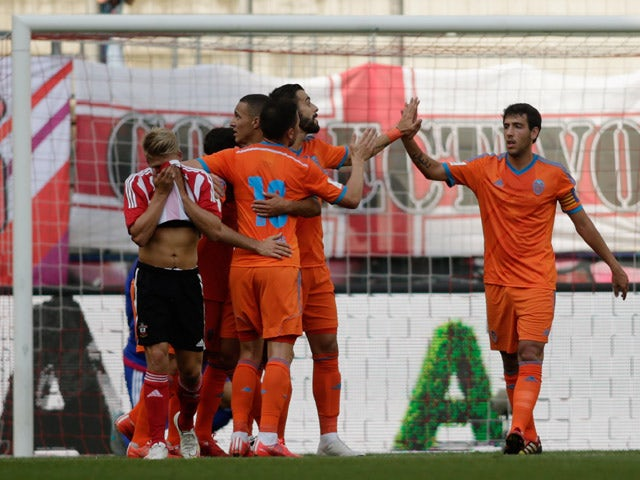 Players of Valencia celebrate after scoring their team's 2nd goal during the pre-season semi final 2 match between Southhampton FC and Valencia CF as part of the Audi Quattro Cup 2015 at Red Bull Arena on July 11, 2015
