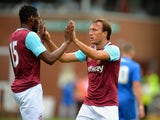 Mark Noble of West Ham United celebrates scoring their first goal during the Pre Season Friendly match between Peterborough United and West Ham United at London Road Stadium on July 11, 2015